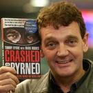Brought to book: former racing driver Tommy Byrne and his new book 'Crashed and Burned'