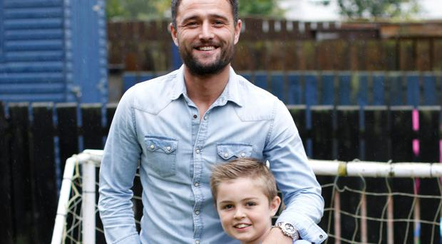 Like father: Jonny Tuffey and his seven-year-old son Carter, who has developed alove for football