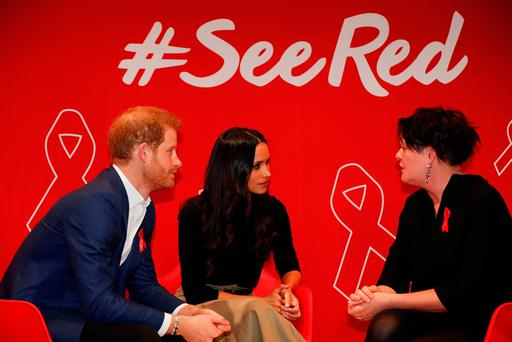 Prince Harry and Meghan Markle attend a Terrence Higgins Trust World AIDS Day charity fair, during a visit to the Nottingham Contemporary in Nottingham, on their first official engagement together. Pic: Adrian Dennis/PA Wire