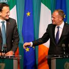 European Council President Donald Tusk (R) and Ireland's Prime Minister (Taoiseach) Leo Varadkar address a joint press conference at the Government buildings in Dublin on December 1, 2017. The European Union will not accept Britain's Brexit offer if Ireland is not satisfied with proposals for future border arrangements, EU President Donald Tusk said in Dublin on December 1. / AFP PHOTO / Paul FAITHPAUL FAITH/AFP/Getty Images