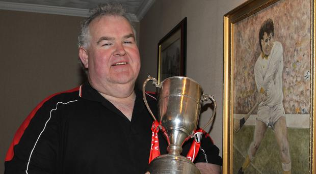 Silver lining: Niall Patterson with the Tommy Moore Cup after Loughgiel won their second All-Ireland Club title in 2012