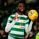Odsonne Edouard of Celtic celebrates with the match ball after he scores a hat-trick.