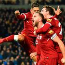 Screaming match: Jordan Henderson leads the celebrations as Liverpool cruise to victory