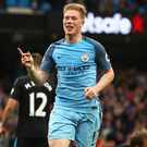 Having a ball: Kevin de Bruyne knows the Manchester derby could be a key step in the title race