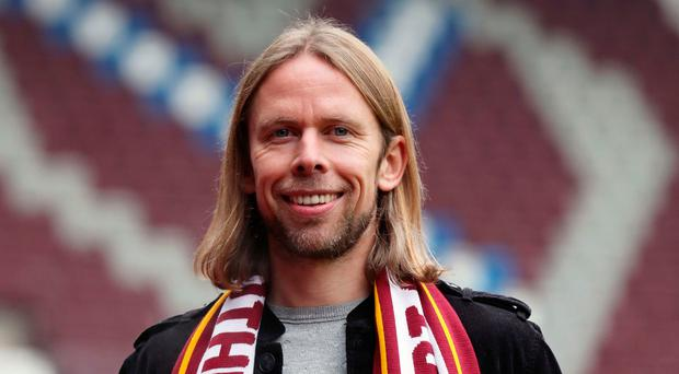 Northern Ireland and Hearts assistant Austin MacPhee clashed with opposition midfielder Darian MacKinnon during his side's 1-1 draw with Hamilton at Tynecastle on Saturday.