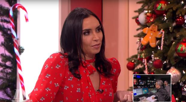 Pictured: Robbie Williams feeds questions to NI presenter Christine Lampard.