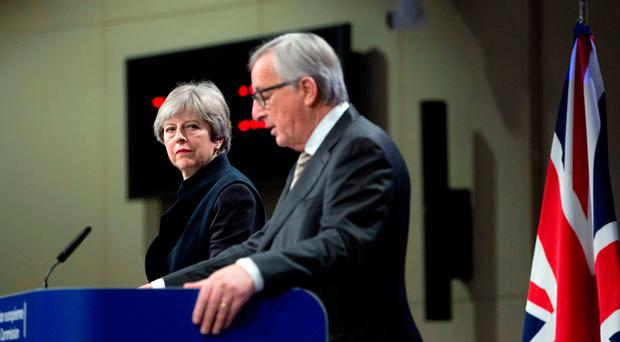 Theresa May with Jean-Claude Juncker in Brussels