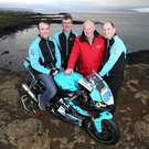 New look: Alastair Seeley (left) with Ian Newton (second left) and Edward Allingham (right) of EHA Racing and Vauxhall International North West 200 Event Director Mervyn Whyte on the North coast as it was announced Seeley will race an R6 Yamaha in EHA livery at the 2018 showpiece
