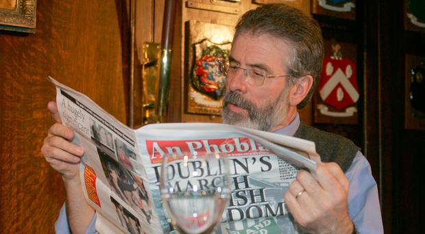 Gerry Adams reads a copy of An Phoblacht