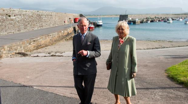 Prince Charles and his wife Camilla during a visit to Mullaghmore, where his uncle Lord Mountbatten was killed in an IRA explosion in 1979