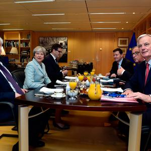 Britain's Secretary of State for Exiting the European Union David Davis (L), Britain's Prime Minister Theresa May (2-L), European Commission President Jean-Claude Juncker (2-R) and European Union's chief Brexit negotiator Michel Barnier (R) meet at the European Commission on December 8, 2017 in Brussels.