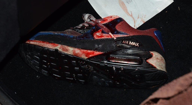 Police have released an image of the bloodied shoe of a shooting victim in a bid to help track down the attackers.