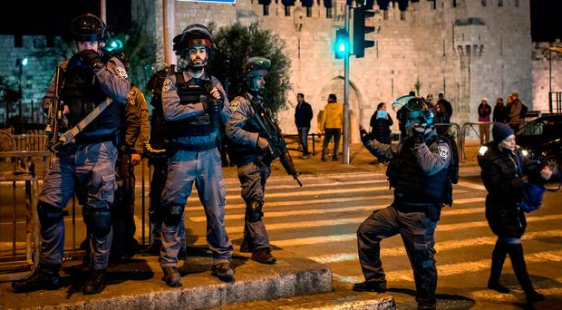 High tensions: Israeli police stand watch outside Damascus Gate in the Old City of Jerusalem