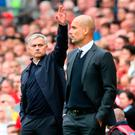 Hands up: Jose Mourinho salutes old foe Pep Guardiola, but has criticised the Spaniard's team