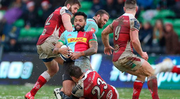 Harlequins Alofa Alofa is tackled by Ulster Rugby's Louis Ludik during the European Rugby Champions Cup, Pool One match at Twickenham Stoop / Credit: Nigel French/PA Wire.