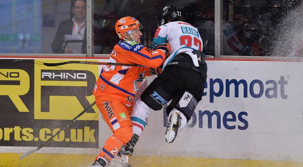 Take that: Belfast Giants' Kevin Raine is slammed into the wall during last night's game