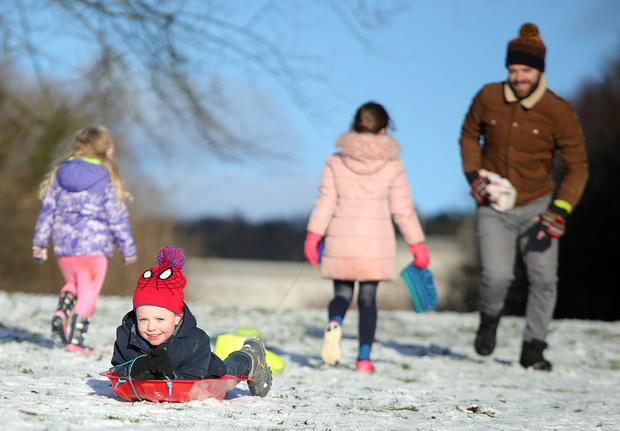 Press Eye Belfast - Northern Ireland 10th December 2017 Four-year-old Noah Adams enjoys the snow at Stormont in east Belfast as it continues to lie across Northern Ireland. Picture by Jonathan Porter/PressEye.com