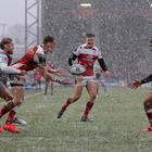 Craig Gilroy of Ulster is tackled by Charlie Walker
