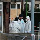 Forensic officers at the scene of a house fire on Jackson Street in Worsley, Greater Manchester, as a murder inquiry has been launched after three children died following the fire. Peter Byrne/PA Wire
