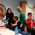 The Duchess of Cambridge helps with setting up the Rugby Portobello Trust's Christmas party, which included children affected by the Grenfell Tower fire, at its community centre in North Kensington yesterday