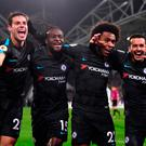 Festive spirit: Pedro (right) celebrates his goal with Cesar Azpilicueta, Victor Moses and Willian