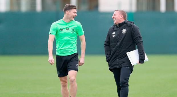 Good times: Brendan Rodgers with defender Kieran Tierney