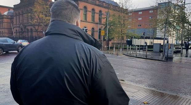 SUNDAY LIFE NEWS - ex-RUC officer Colin Keys outside the court