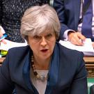 Prime Minister Theresa May speaks during Prime Minister's Questions in the House of Commons, London / Credit: PA Wire