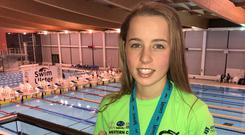 Making a splash: Ellie McCartney shows off her haul from the Ulster championships