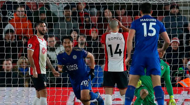 All smiles: Shinji Okazaki wheels away with delight after scoring the first of his double against Southampton