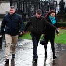 Jayda Fransen, right, arrives at Belfast Laganside Courts along with Paul Golding, left, on December 14, 2017 in Belfast, Northern Ireland. The Britain First deputy leader is charged with using
