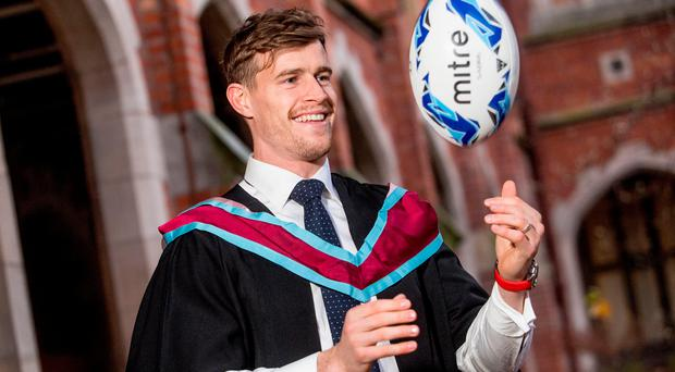 Andrew Trimble celebrates his Masters degree