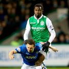 Tight encounter: Hibs' Efe Ambrose and Rangers ace Jason Holt battle for the ball