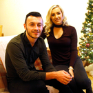 Festive feeling: Jonny Frazer and girlfriend Aimee get into the Christmas spirit at their apartment