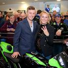 Treble yell: Jonathan Rea and wife Tatia celebrate World title hat-trick