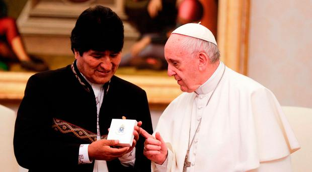 Different direction: Pope Francis meets with President of Bolivia Evo Morales during a private audience at the Vatican