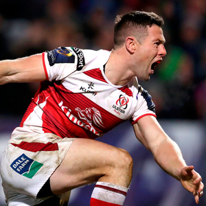 Pointing the way: John Cooney celebrates an Ulster try on his way to 27 point personal total