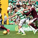 Celtic v Heart of Midlothian - Ladbrokes Scottish Premiership - Celtic Park...Celtic's Scott Brown (left) and Heart's Kyle Lafferty during the Ladbrokes Scorrish Premiership match at Celtic Park, Glasgow. PRESS ASSOCIATION Photo. Picture date: Saturday August 5, 2017. Ian Rutherford/PA Wire.