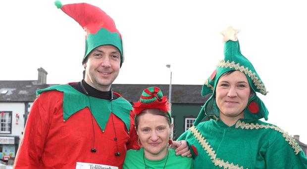 Press Eye -Belfast Telegraph Born 2 Run Forest Run Series 5k and 10k - Kibroney - 16th December 2017 (L-R) Vincent McClory, Lindsay Morton and Simone Cully