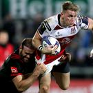 Strong arm: Ulster's Craig Gilroy is tackled by Jamie Roberts