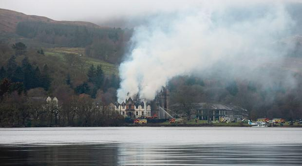 Firefighters at the scene following a fire at the Cameron House Hotel on the banks of Loch Lomond in Scotland. PRESS ASSOCIATION Photo. Picture date: Monday December 18, 2017. Two adults and a child, believed to be from one family, were taken to hospital in Glasgow for treatment. See PA story SCOTLAND Hotel. Photo credit should read: Andrew Milligan/PA Wire