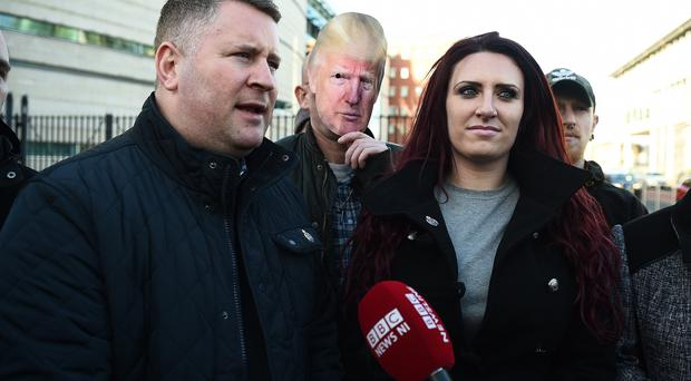 Britain First leader Paul Golding and deputy leader Jayda Fransen talk to the media along with a supporter wearing a Donald Trump mask outside Belfast Laganside Courts on December 15, 2017. (Photo by Charles McQuillan/Getty Images)