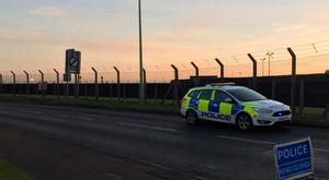 Police outside RAF Mildenhall in Suffolk, after shots were fired by US service personnel and a suspect was arrested after a disturbance at the base. Pic: Graham Clark/PA Wire