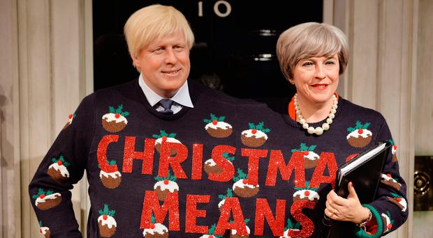 Wax figures of Prime Minister Theresa May and Foreign Secretary Boris Johnson wearing a festive jumper, in support of Save the Children's Christmas Jumper Day, at Madame Tussauds in London. PRESS ASSOCIATION Photo John Stillwell/PA Wire