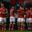 Bristol City's Scottish defender Joe Bryan celebrates with teammates, scoring the team's first goal during the English League Cup quarter-final football match between Bristol City and Manchester United.