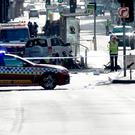 Police and emergency personnel work at the scene of where a car ran over pedestrians in Flinders Street in Melbourne on December 21, 2017.