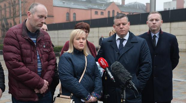 Relatives of those killed at Loughinisland and supporters outside Belfast High Court yesterday