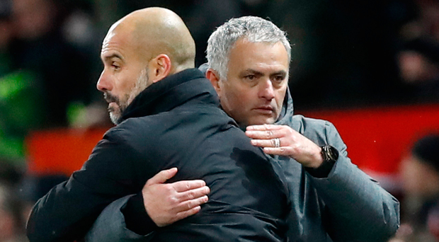 Hug it out: Jose Mourinho and Pep Guardiola embrace after the derby
