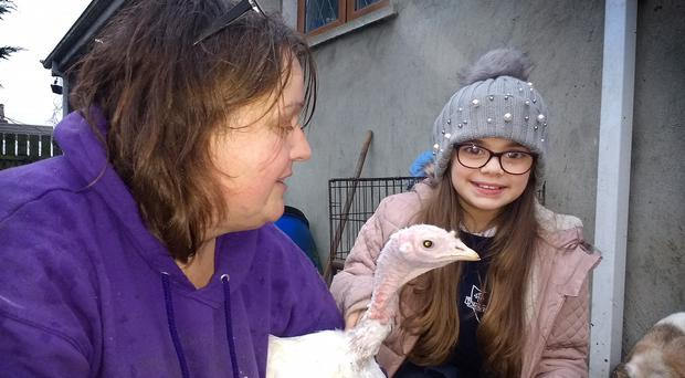 Barbara Mladek and Annabelle with her turkey named Hope