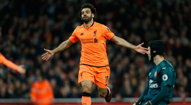Class act: Mohamed Salah after scoring Liverpool's second